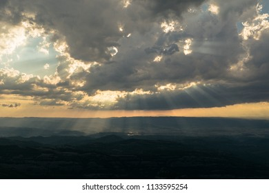 Sunlight on cloudy landscape