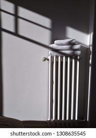 Sunlight on radiator and towels