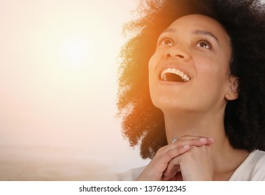 Sunlight on Young Prayer Woman face. Faith, Happiness , Gratitude to God expression