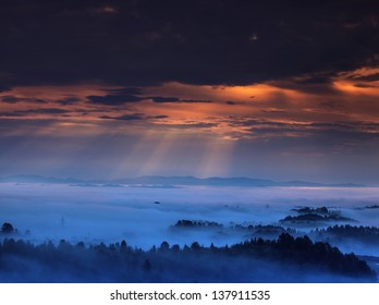 sunlight over the landscape in the fog