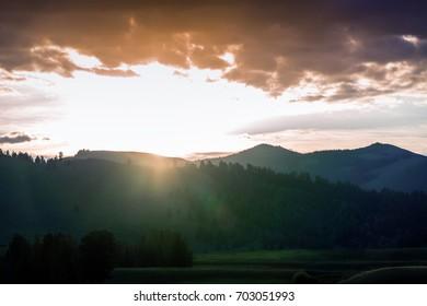Sunlight Over the Mountain