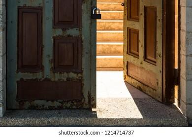Sunlight passes through open vintage doors