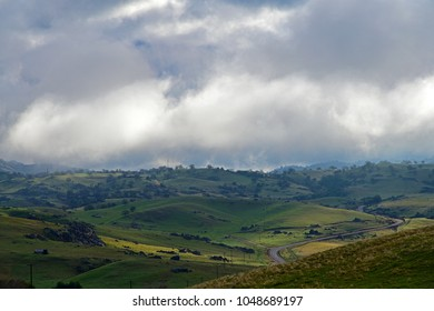 Sunlight plays through the clouds onto the valley floor. Central California in the foothills of the Sierra Nevada Range.