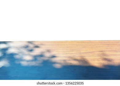 sunlight shine on empty wood table with shadow of tree, wooden shelf display on white background