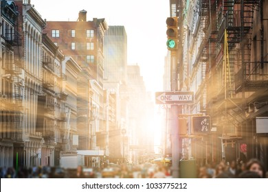 Sunlight shines on people walking the streets of SoHo in New York City