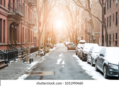 Sunlight shines on snow covered Barrow Street in Greenwich Village, Manhattan New York City