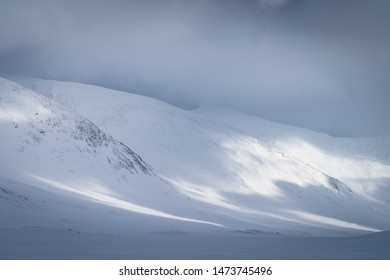 Sunlight shining on a snow covered valley in Sarek,  Lapland. Sweden.