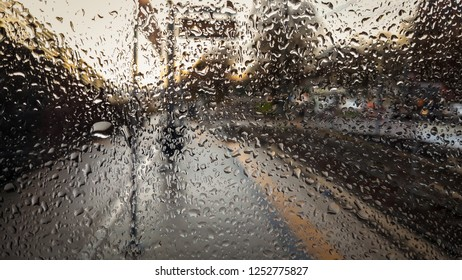 Sunlight is shining through a Window with many Raindrops.