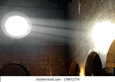 sunlight that enters from the ancient Christian Church rose window and illuminates the ancient brick wall