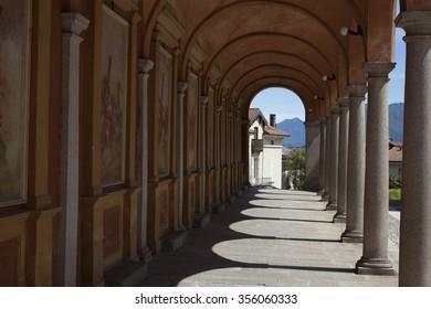 Sunlight through the arches of a corridor in a church