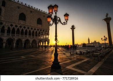 Sunlight through lamp post of saint mark square plaza in Venice, Italy