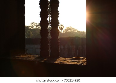 sunlight through the patterned window of the Cambodian temple