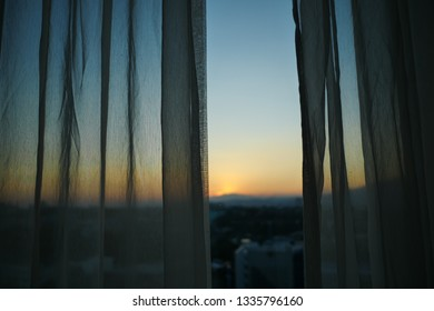 sunlight through white curtain with sunset sky view outside the window