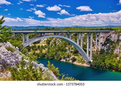 Sunlight view on the Sibenik Bridge a long concrete arch bridge passing through the canyon of the Krka River. Location Skradin town, Croatia, Europe. Scenic image of travel destination.