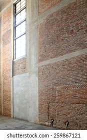 Sunlight from window on the brick walls inside of old building