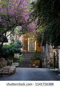 Sunlit ancient door with trees and staircase near the Sursock Palace area in Beirut, Lebanon
