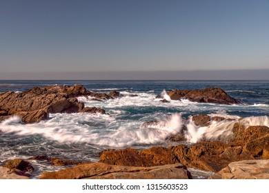 Sunlit cliffs at dusk at  Point Lobos State Natural Reserve.