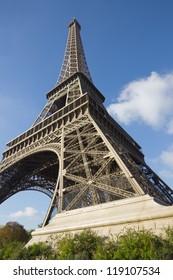 sunlit Eiffel Tower, Paris, against blue sky