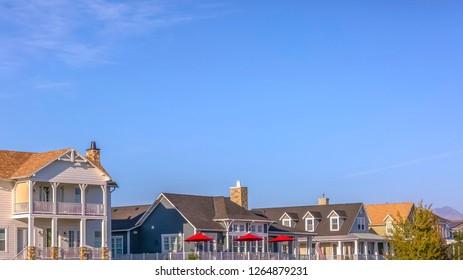 Sunlit homes in Daybreak Utah under clear blue sky