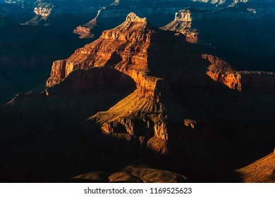 Sunlit rock formations in Grand Canyon National Park in summer, Arizona, USA.