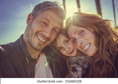 sunlit sefie of family members outdoors