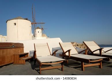 Sunlounger at the terrace in Santorini, Greece