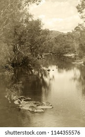Sunning sepia colored Ibis creek near Irvinebank on the Atherton Tableland in Queensland, Australia