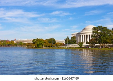 A sunny afternoon near the water of Tidal Basin in Washington DC in autumn. Washington DC panorama with city architectural landmarks.