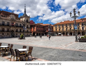 A sunny afternoon at Plaza Mayor in Leon, Spain. Tables and chairs arranged for al fresco dining.