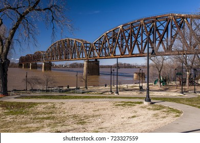 A sunny afternoon view of a mammoth railroad Warren through truss bridge over the Ohio River between Henderson, Kentucky and Indiana.