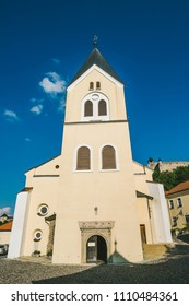 Sunny autumn day in old town of Trencin, Slovakia. White church.