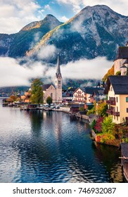 Sunny autumn scene of Hallstatt lake. Splendid morning view of Hallstatt village, in Austria's mountainous Salzkammergut region, Austria. Beauty of countryside concept background.