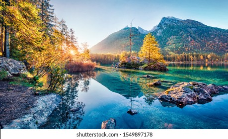 Sunny autumn view of Hintersee lake with Hochkalter peak on background, Germany, Europe. Spectacular morning view of Bavarian Alps. Beauty of nature concept background.