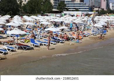SUNNY BEACH, BULGARIA - AUGUST 29: People visit  Sunny Beach on August 29, 2014. Sunny Beach is the largest and most popular seaside beach resort in Bulgaria.