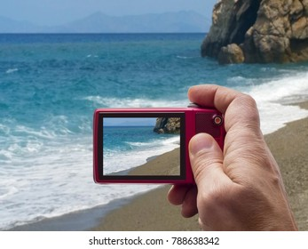 Sunny beach in camera viewfinder