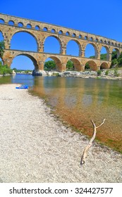 Sunny beach in front of Pont du Gard - an ancient Roman aqueduct near Nimes, France