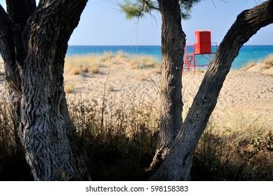 Sunny beach in Greece with blue sky