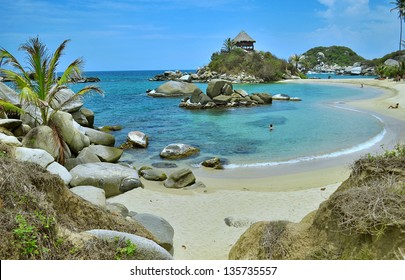 Sunny beach on the blue Caribbean sea in Colombia