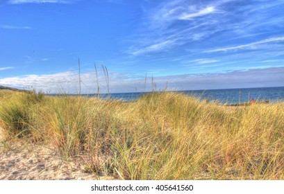 Sunny beach with sand dunes and colorful blue sky