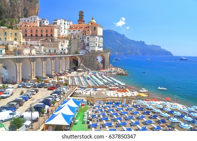 Sunny beach under historical buildings of Atrani, Amalfi coast, Italy