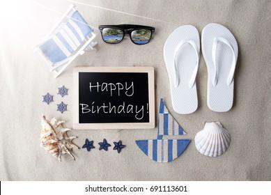 Sunny Blackboard On Sand With Text Happy Birthday