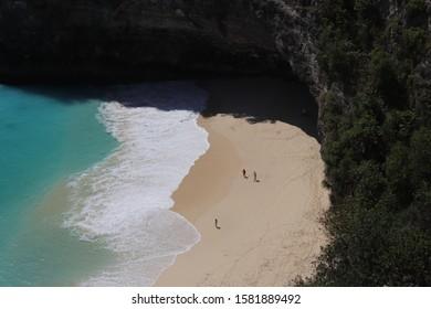Sunny blue beach side in Bali, Indonesia.