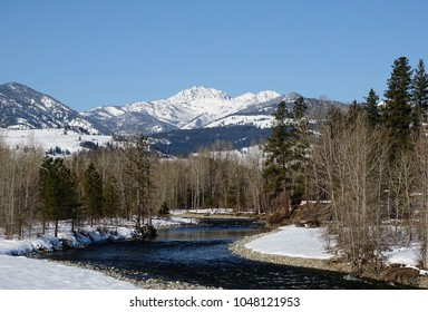 Sunny, blue sky day over the Methow River in winter with Mt. Gardner in the background
