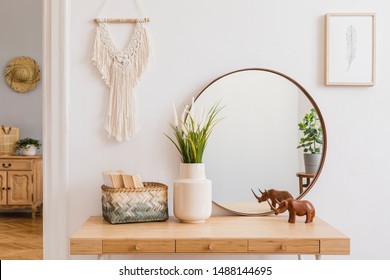 Sunny boho interiors of apartment with mirror, dressing table, furnitures, flowers, plants, rattan box, books, sculpture, macrame and design accessories. Stylish home decor of open space. Template. - Shutterstock ID 1488144695