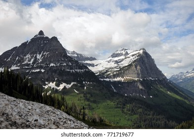Sunny bright day with blue skies amid snow-covered mountains at Glacier National Park