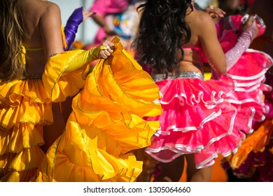 Sunny close-up of the colorful ruffled dresses of Carnival costumes dancing in bright sunlight in Rio de Janeiro, Brazil