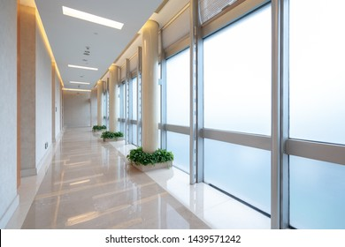 Sunny corridors flanked by floor-to-ceiling Windows