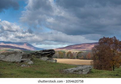 sunny country landscape with rock outcrop
