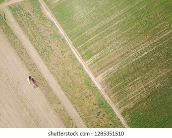 In sunny day aerial shots about harvesting of a field by a drone.