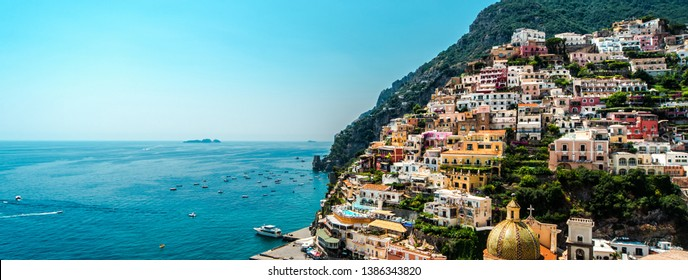Sunny day in amazing Amalfi coast panoramic view, colorful hillside houses on the mountain, blue Mediterranean Sea famous tourist resort Positano, copy space for touristic advertisement text, Italy